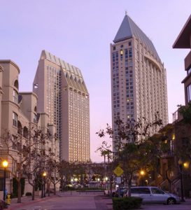 A view of the local architecture in Downtown San Diego, California, USA, at dusk. A street view of the light posts, the skyscrapers, hotel, offices and residetial buildings in the Marina's waterfront.